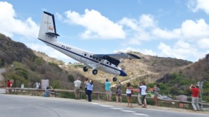 A Winair DHC-6-300 Twin Otter makes its usual approach into St. Barths. Courtesy Alain Duzant